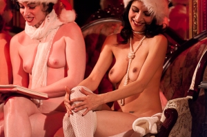 Photos of naked women reading A Christmas Carol